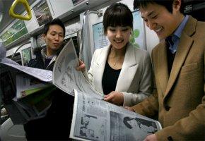 Elektronische Zeitung in der U-Bahn lesen