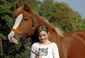 Kind mit seinem Pferd